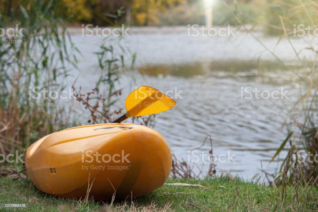 Yellow kayak on the lake stock photo