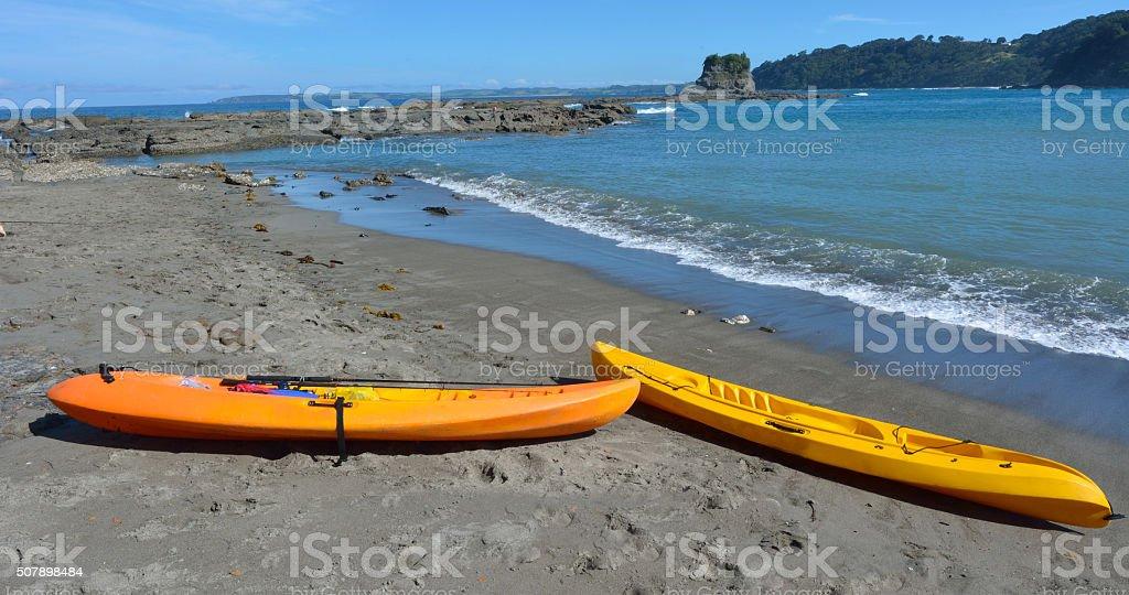 Yellow Kayas in Matheson Bay New Zealand stock photo