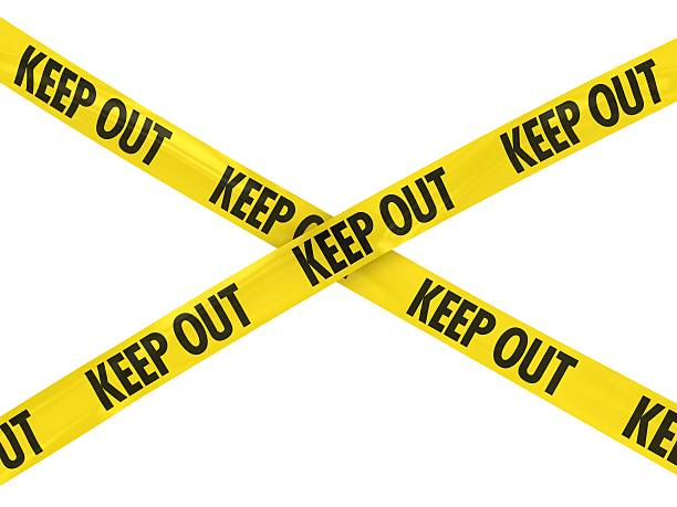 Yellow KEEP OUT Barrier Tape stock photo