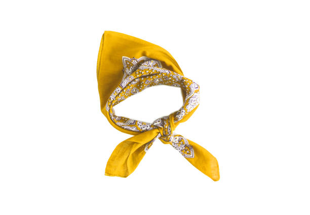 Yellow kerchief-bandana with a pattern, isolated stock photo