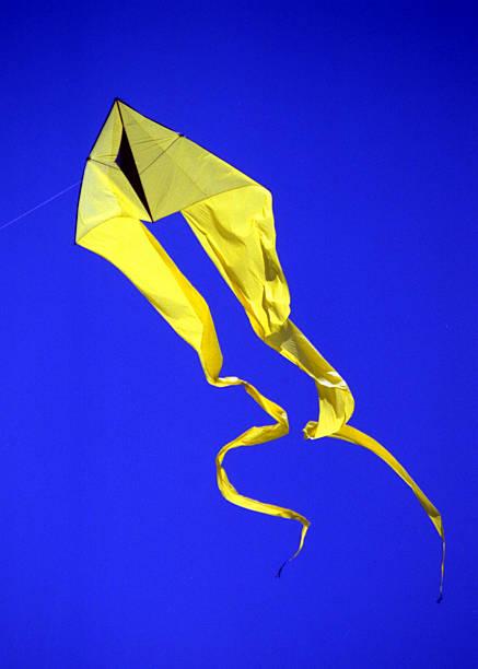 Yellow Kite Blue Sky stock photo