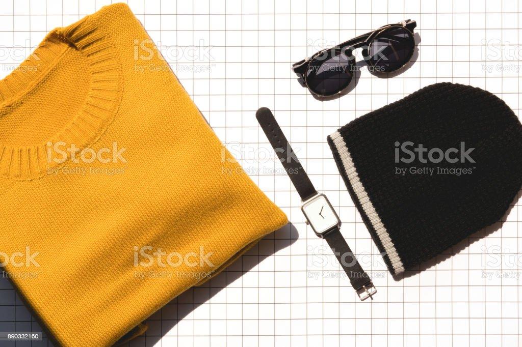 yellow knitting sweater with Wool hat,wristwatch and sunglasses to present fashion of winter season stock photo