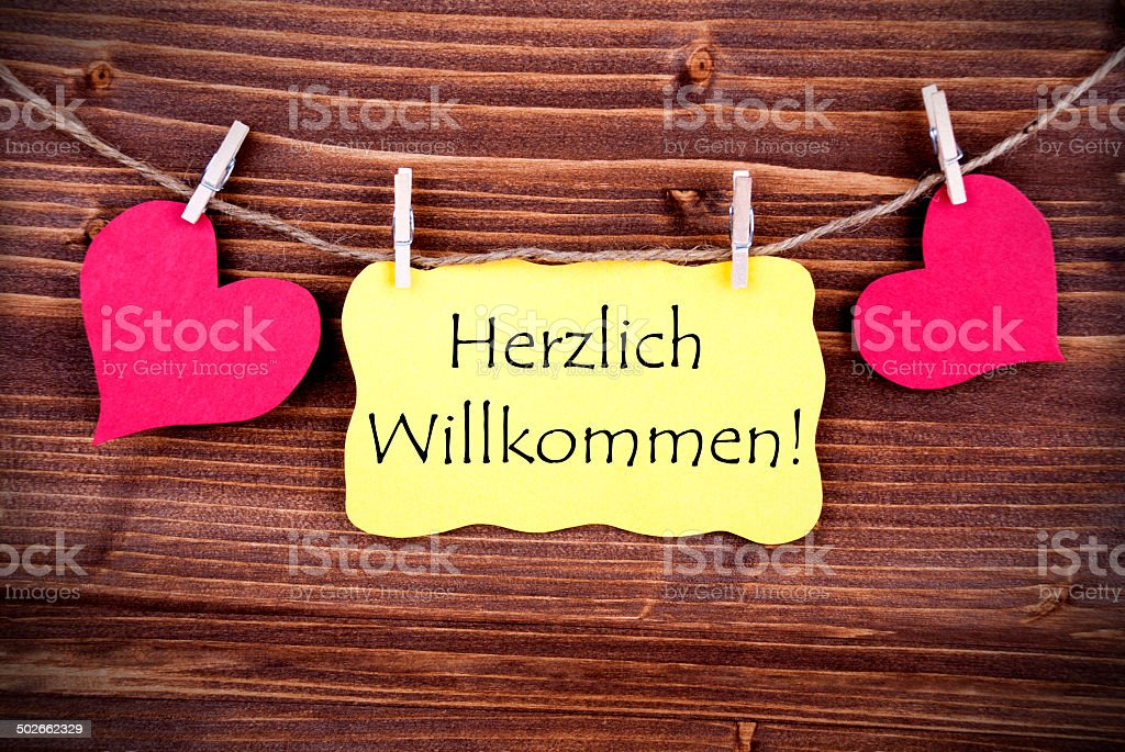 Yellow Label with Herzlich Willkommen stock photo