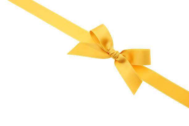 Yellow lace and bow over a white canvas for a Christmas gift stock photo