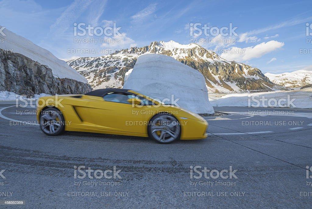 Yellow lamborghini car in a hairpin turn stock photo