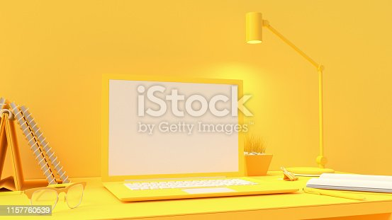 istock Yellow laptop mock-up on Work desk 1157760539