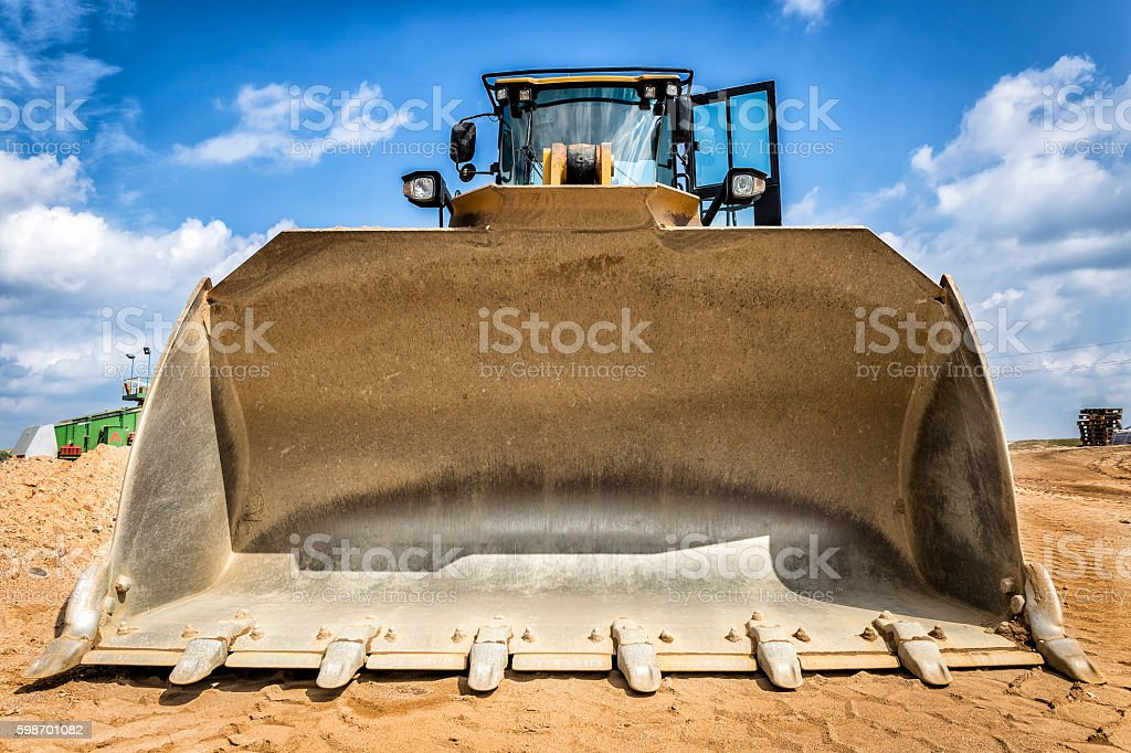 Yellow large earth mover's scoop stock photo