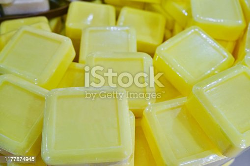 Yellow large pieces of soap with essential oils and extracts for sale in the gift shop