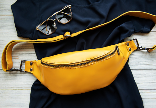 Fashionable stylish belt leather bag in yellow color