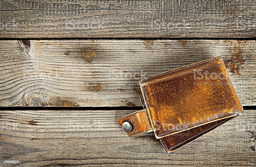 Yellow leather wallet on a wooden background