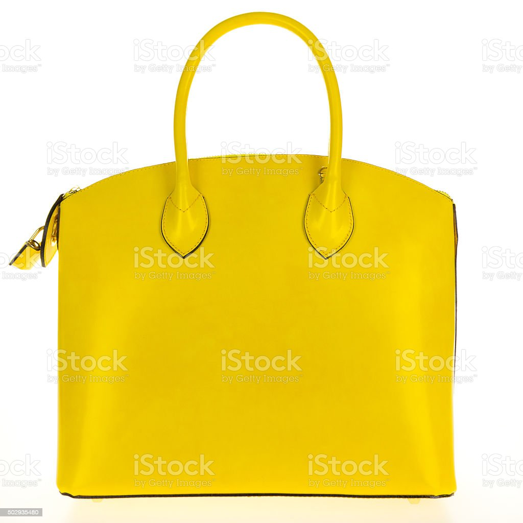 Yellow leather women's tote handbag on white background stock photo