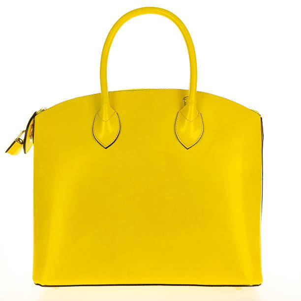yellow leather women's tote handbag on white background - handtas stockfoto's en -beelden