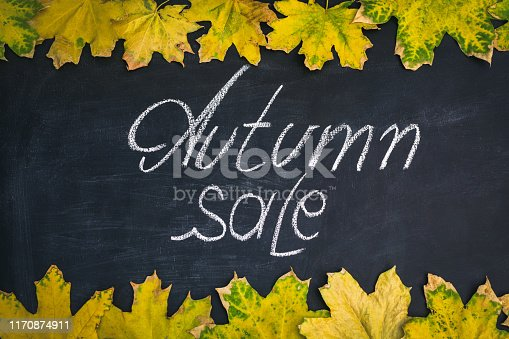 istock yellow leaves and inscription autumn on a blackboard 1170874911