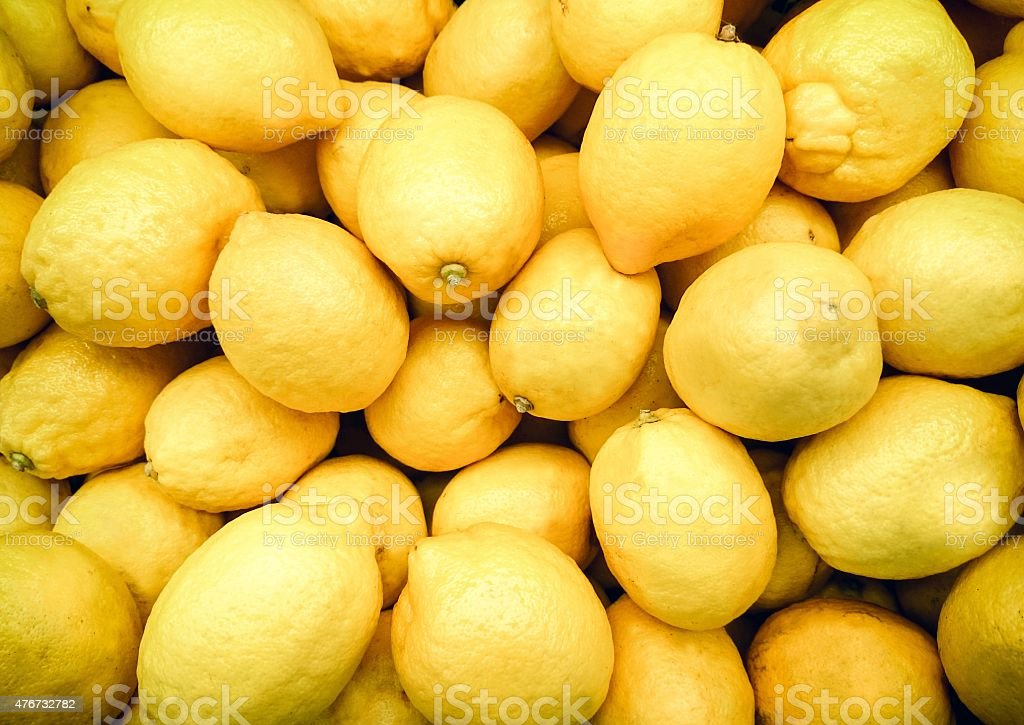 Yellow lemons in the supermarket stock photo