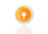Yellow light bulb innovation icon with white frame on white background. Horizontal composition. Clipping path is included.