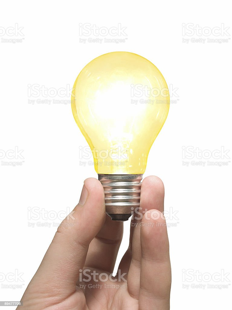 Yellow light bulb in hand royalty-free stock photo