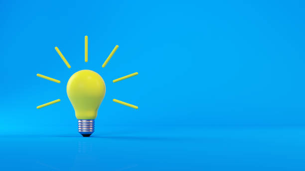 gelbe glühbirne auf blauem hintergrund - idee stock-fotos und bilder