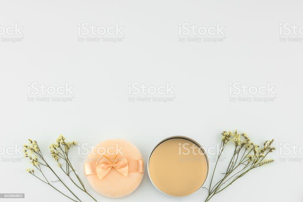 Yellow limonium caspia flowers and powder and puff stock photo
