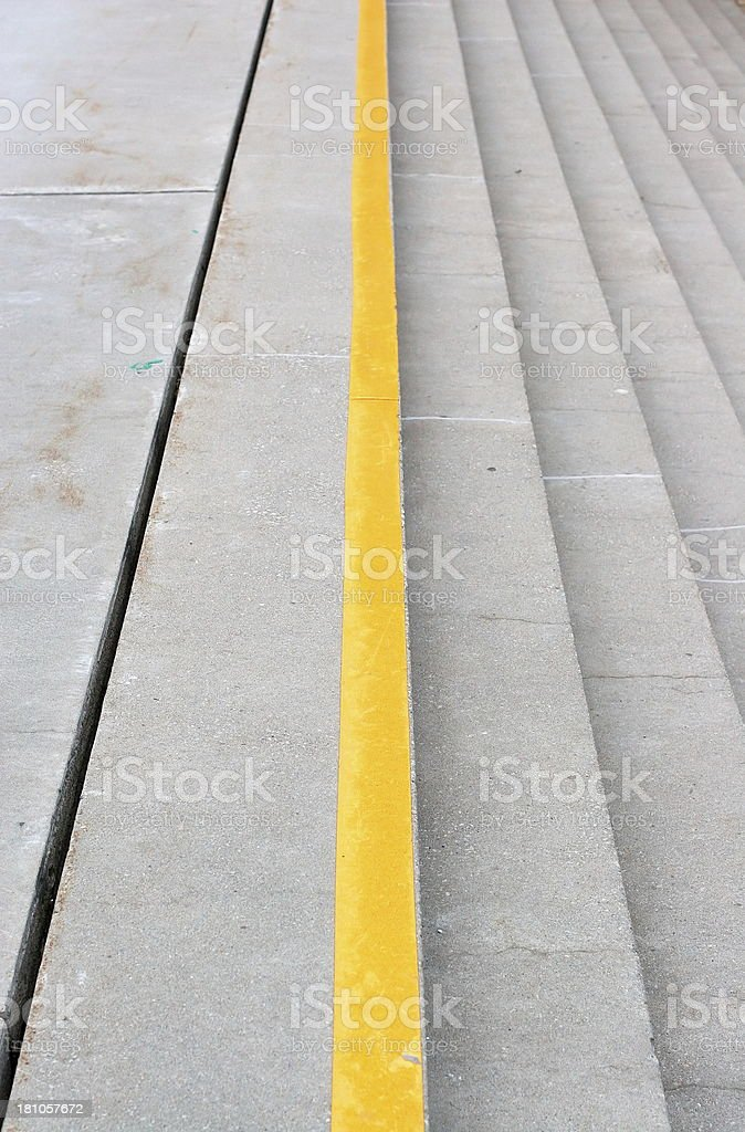 Yellow Line at Top of Concrete Stairs royalty-free stock photo