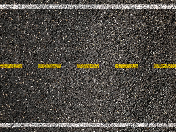 yellow line on asphalt road background - dotted line stock photos and pictures
