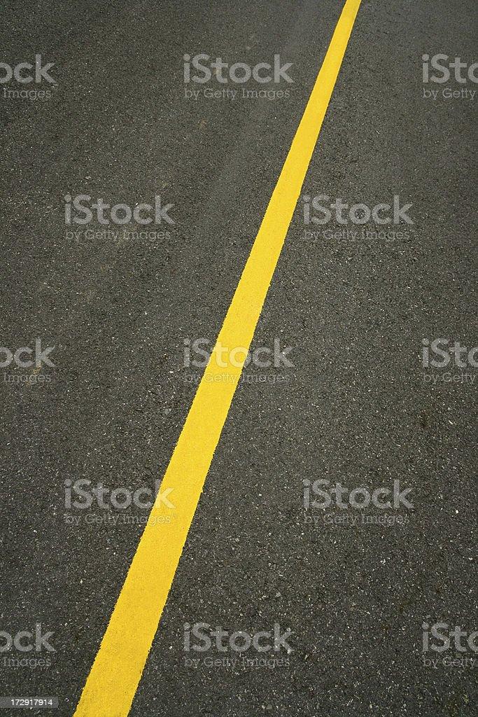 Yellow Line on Blacktop Road stock photo
