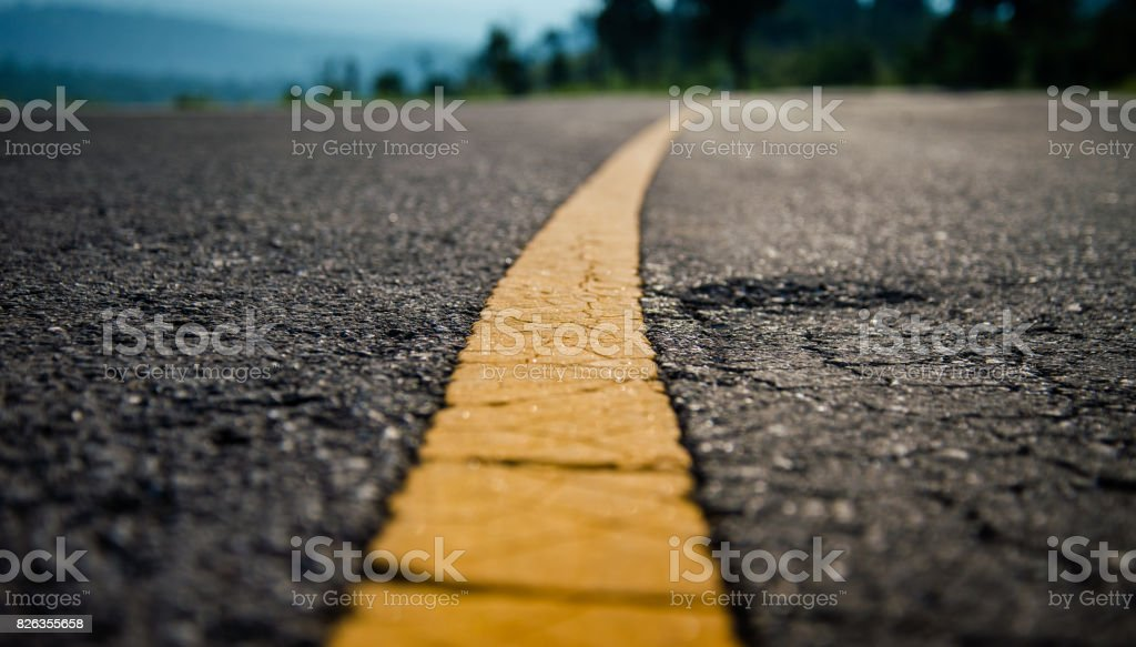 Yellow line on road stock photo