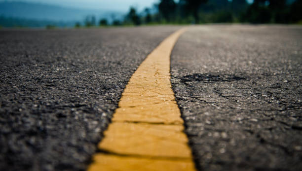 yellow line on road - bumpy stock pictures, royalty-free photos & images
