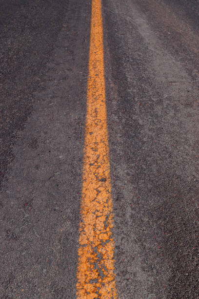 Yellow line on the road stock photo