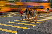 Hong Kong. China - May 6, 2014: Yellow line, woman, walking, waiting,Night Traffic Hong Kong Island,China ,South Asia,Nikon D3x