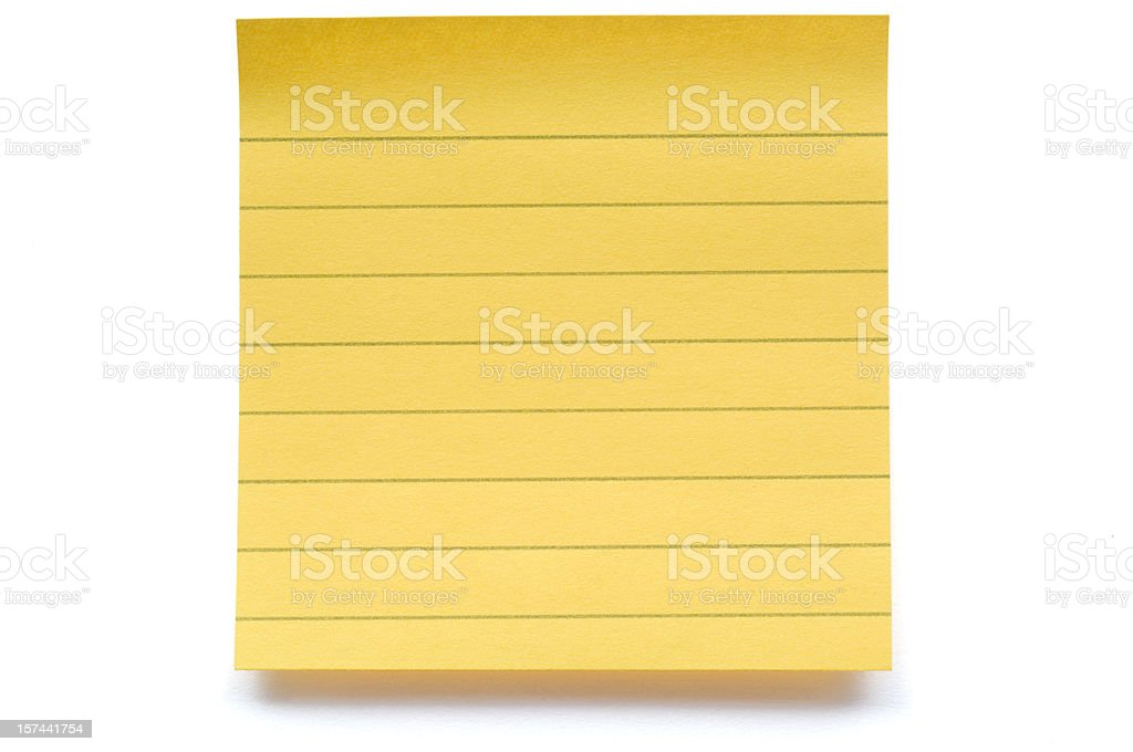 Yellow lined post-it note close-up royalty-free stock photo