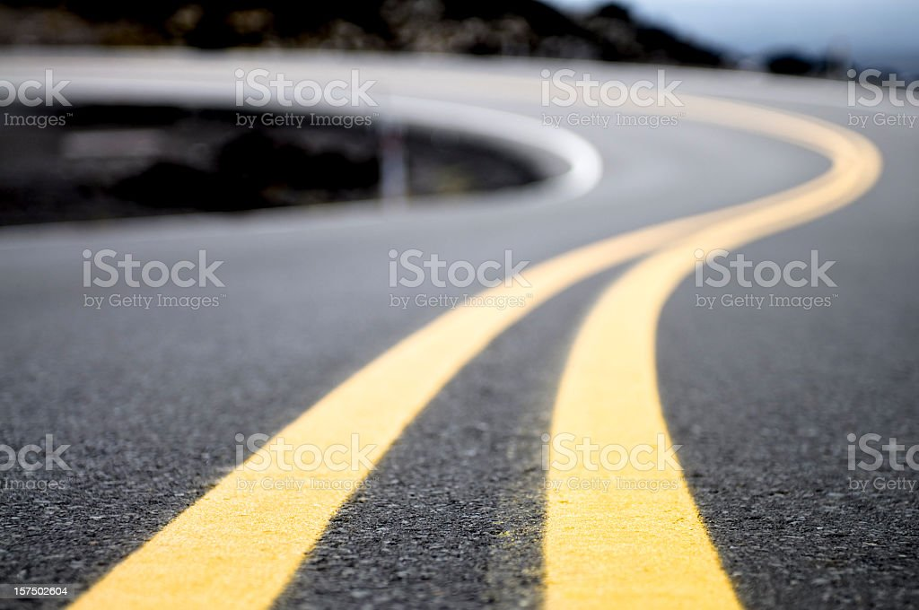 Yellow Lines on a Winding Road stock photo