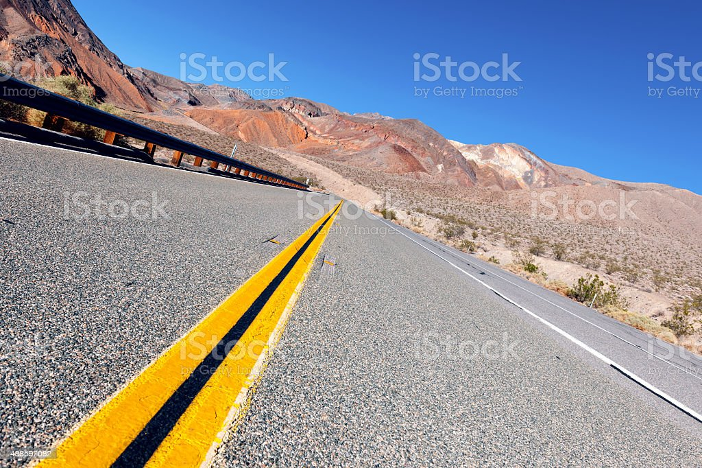 Yellow Lines on Daylight Pass Road Death Valley USA stock photo