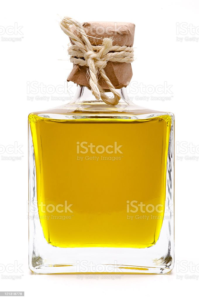 Yellow liquid, olive oil, in a small glass bottle royalty-free stock photo