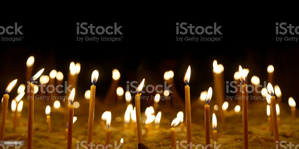 Yellow lit candles stock photo