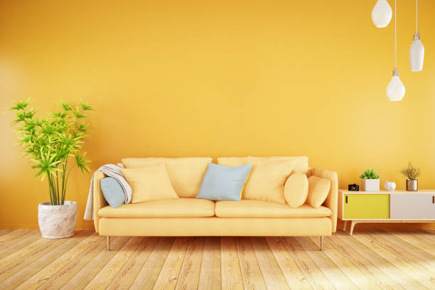 yellow living room with sofa - vibrant color stock pictures, royalty-free photos & images