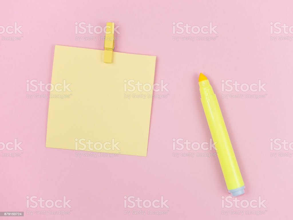 yellow magic pen and paper note and paperclip on pink background, minimal concept and similarities differences stock photo