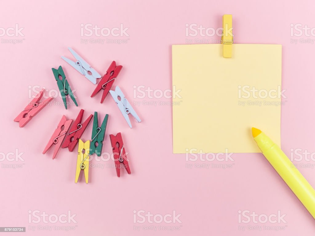 yellow magic pen and paper note with colorful paperclip on pink background, minimal concept and similarities differences stock photo