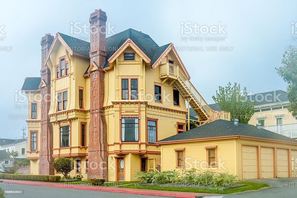 yellow mansion, Victorian style stock photo