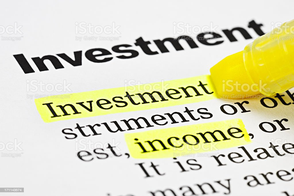 Yellow marker highlights 'Investment 'and 'income' on printed page royalty-free stock photo