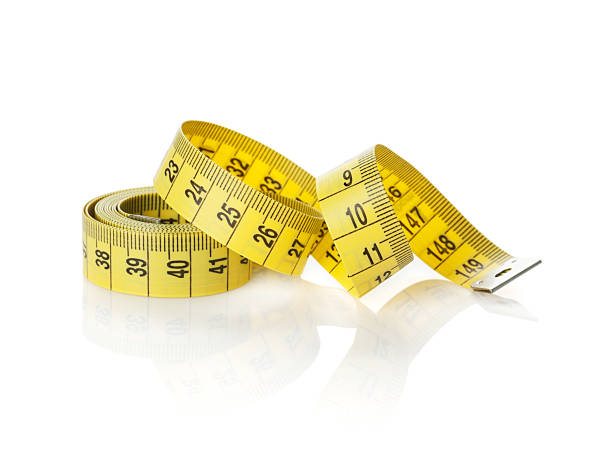Yellow measure tape Yellow measure tape. Isolated on white background tape measure stock pictures, royalty-free photos & images