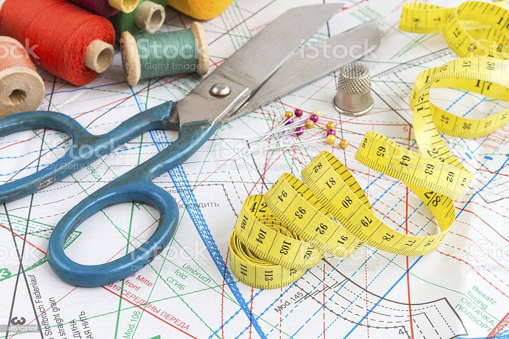 Yellow measuring tape and sewing items stock photo
