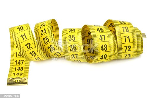 1184112328 istock photo Yellow measuring tape isolated on white background 958952866