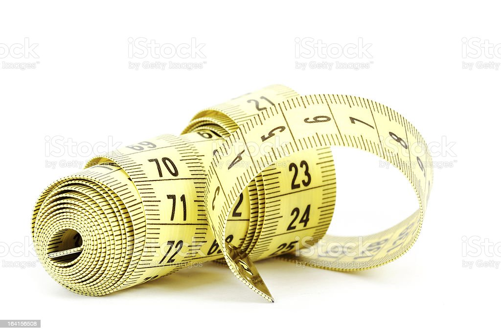 Yellow measuring tape isolated on white royalty-free stock photo