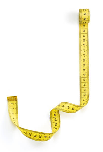 yellow measuring tape isolated on white yellow measuring tape isolated on white background tape measure stock pictures, royalty-free photos & images