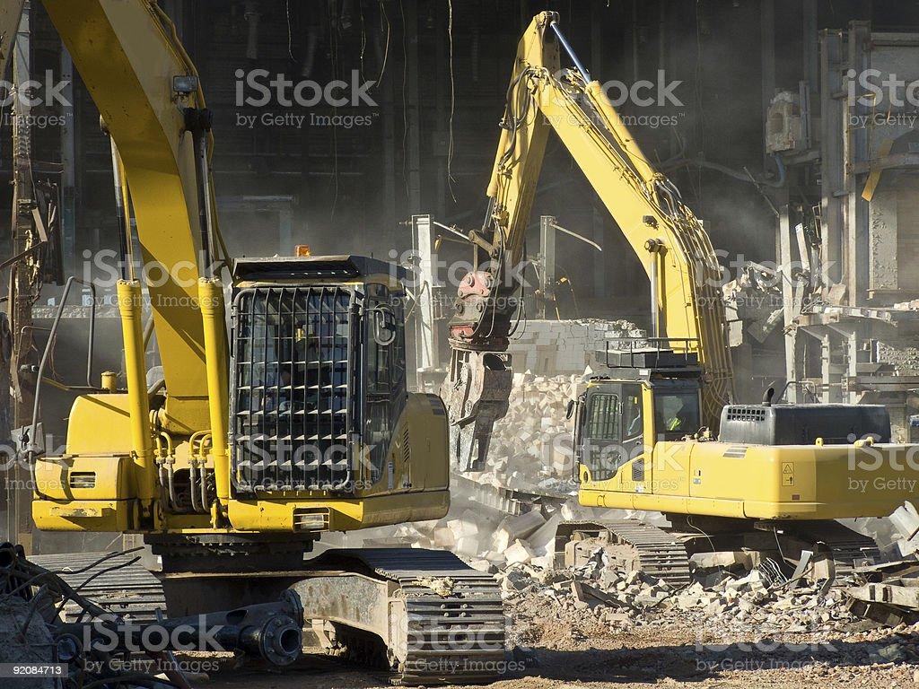 Yellow Mechanical Excavators Demolishing a Factory royalty-free stock photo