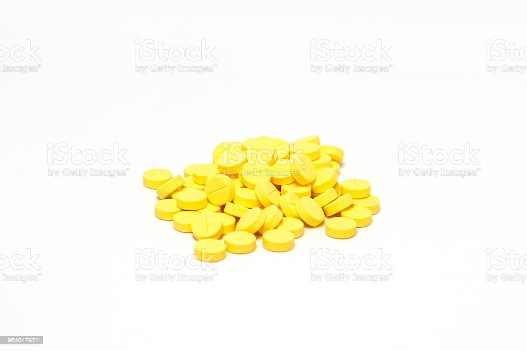 Yellow medicine pill cure heal drug group close up isolated on white background - Royalty-free Addiction Stock Photo