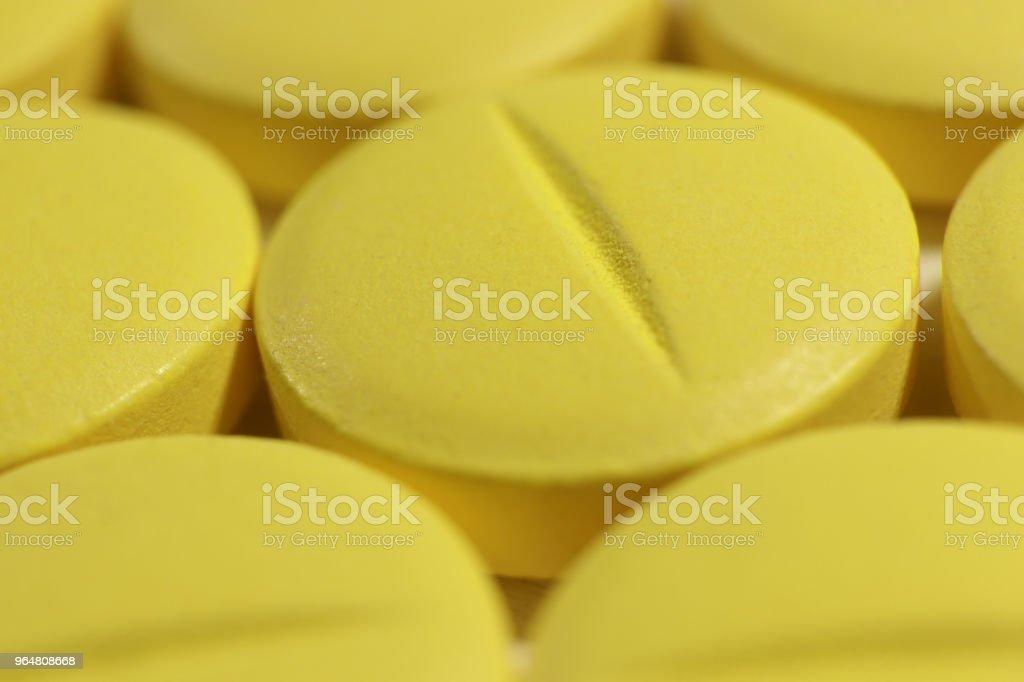 Yellow Medicine Tablets. Pharmacy Pills Background. Macro Closeup. royalty-free stock photo