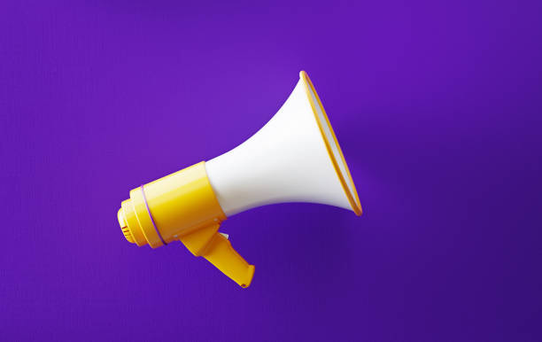 Yellow Megaphone On Purple Background Yellow megaphone on purple background. Horizontal composition with copy space. Great use for announcement concepts. customer engagement stock pictures, royalty-free photos & images