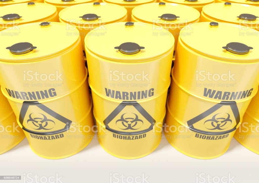 Yellow metal barrels with black biohazard warning sign isolated stock photo