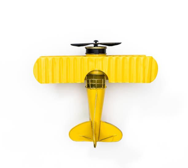 Avión de juguete de Metal amarillo aislado en blanco - foto de stock